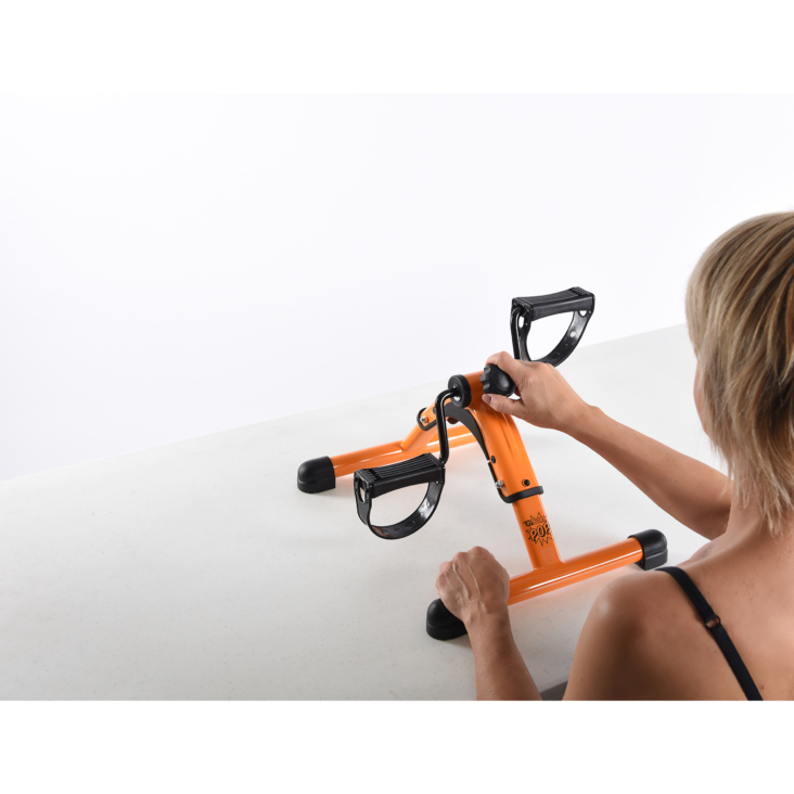 Woman workout on InStride POP Fitness Cycle Orange