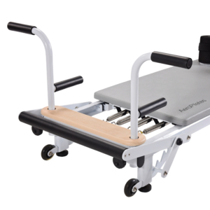 Close up of side view of metal pilates equipment with handles