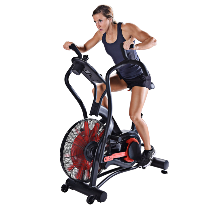 Young woman seated and cycling on Stamina X Air Bike Exercise.